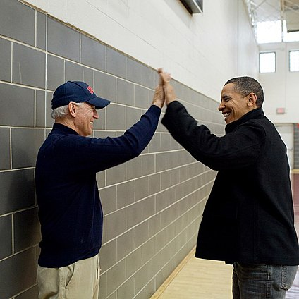 Joe Biden hifiving Barack Obama.jpg