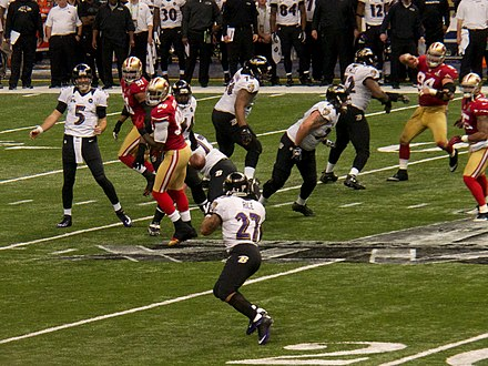 Baltimore Ravens quarterback Joe Flacco attempts a pass to Ray Rice.