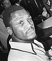 Joe Frazier reading newspaper cropped.jpg