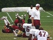 Gibbs coaching players during the 2005 training camp.