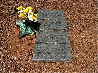 John Doe - Headstones marking the final resting place of four unknown people indicated by the names John Doe and Jane Doe, Pima County Cemetery, Tucson, Arizona.