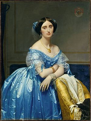 1850s in Western fashion - The Princesse de Broglie wears a blue silk evening gown with delicate lace and ribbon trim. Her hair is covered with a sheer frill trimmed with matching blue ribbon knots. She wears a necklace, tasseled earrings, and bracelets on each wrist.