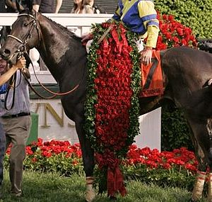 "Kentucky Derby Trophy - The official ""Garland of Roses"" is presented in the winner's circle after the race"