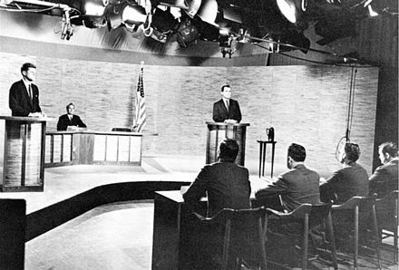 Kennedy and Richard Nixon participate in the nation's first televised presidential debate, Washington, D.C., 1960 Kennedy Nixon Debat (1960).jpg