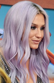 A closeup picture of Kesha with long mauve hair.