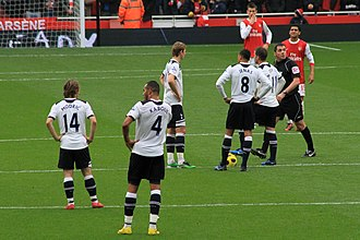 Luka Modrić - Modrić (far left, No. 14), preparing for a match kick-off for Tottenham against Arsenal in November 2010.