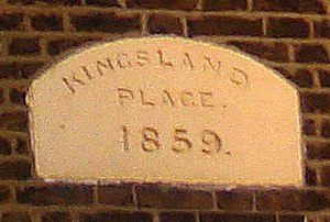 Kingsland, London - Before the railway came: This plaque, on a block of houses near the top of Kingsland Road, is from a time when the name could still be used with some confidence. (October 2005)