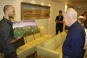 Jonathan Kis-Lev - Kis-Lev with artwork with Israeli President Shimon Peres in a fundraising event, 2013