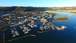 An areal view of Knysna and its Waterfront area with the Lagoon visible in the background to the right.