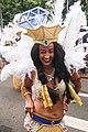Lachende vrouw met witte veren zomercarnaval Rotterdam.jpg