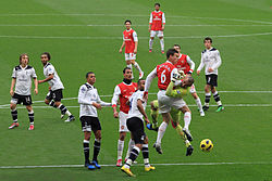 Laurent Koscielny clashes with Heurelho Gomes.jpg