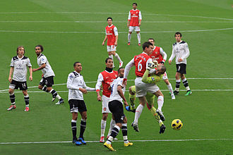 Arsenal against rivals Tottenham, known as the North London derby, in November 2010 Laurent Koscielny clashes with Heurelho Gomes.jpg