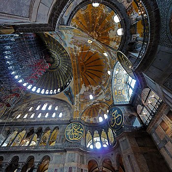 Interior view upward to the byzantine domes and semi domes of hagia sophia see commons file for annotations