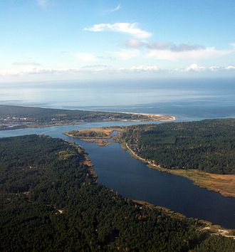 Lielupe - The Lielupe flows into the Baltic Sea, while the Buļļupe branch flows towards the Daugava River to the northeast.