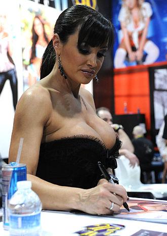 Lisa Ann - Lisa Ann signing merchandise at the 2013 AVN Expo