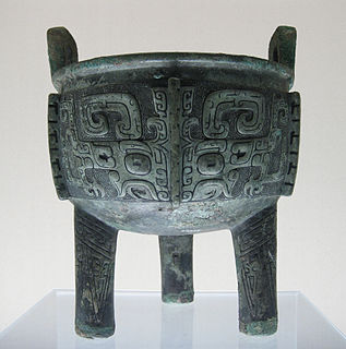 <i>Ding</i> (vessel) ancient Chinese cauldron, standing upon 3 or 4 legs with a lid and two facing handles