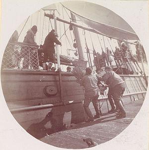 USS Bear (1874) - Men loading Reindeer onto USRC Bear.