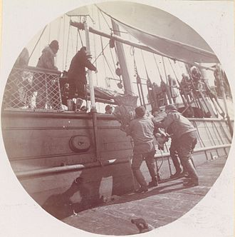 USS Bear (1874) - Men loading Reindeer onto USRC Bear.