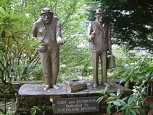Extortion - Loot and Extortion. Statues at Trago Mills, poking fun at the Inland Revenue.