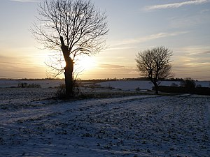 English: Low winter sun towards Steeple Gidding