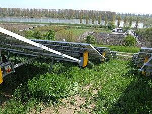 SMA Solar Technology - A Sunny Mini Central mounted next to photovoltaic solar modules