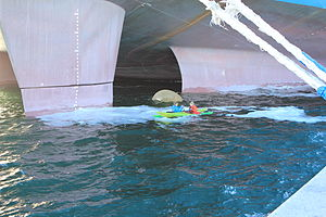Maersk Triple E-class container ship - Kayakers under the twin-skeg stern