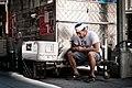 Man sitting on food truck (Unsplash).jpg