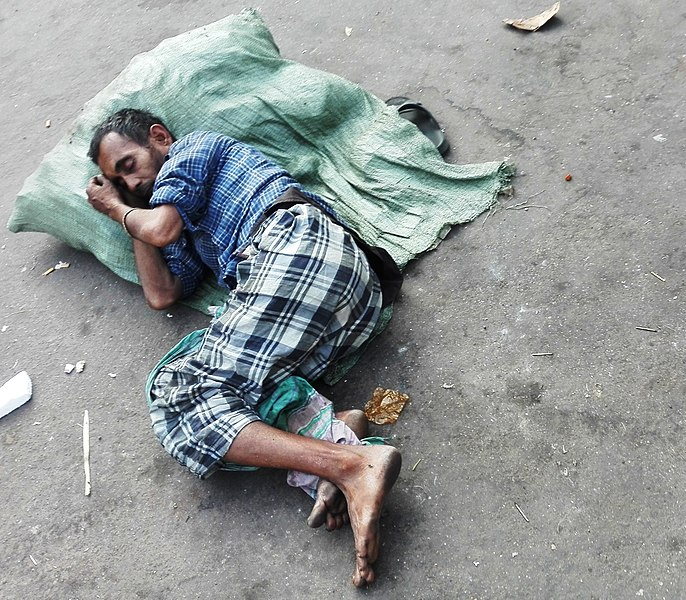 File:Man sleeping on road at dhaka.jpg