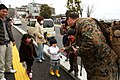 Marines hand out candy to children (5559327196).jpg