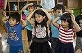 Marines teach English to Okinawa students through song, play during new program 140919-M-PJ295-342.jpg
