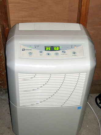 "Dehumidifier - A typical ""portable"" dehumidifier can be moved about on built-in casters"