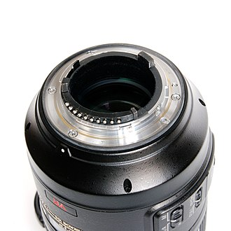Nikon F-mount - The flange of a current F-mount lens, including aperture lever (upper left) and CPU contacts (bottom).