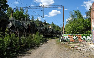 Military railways - Finnish military vehicles being transported by train, 2008