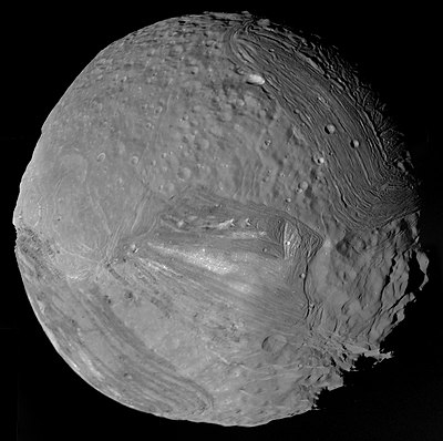 Voyager 2 image of Miranda's broken terrain. Verona Rupes is located at the bottom right of Miranda. Miranda - January 24 1986 (30906319004).jpg