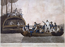 A small open boat, crowded with men, lies astern of a larger vessel. In the small boat a white-clad figure is standing, remonstrating with the figures on the larger boat, some of whom are throwing objects to the open boat.