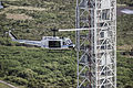 "NASA UH-1 ""Huey"" helicopter flies past the Mobile Launcher.jpg"