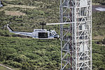 """NASA UH-1 """"Huey"""" helicopter flies past the Mobile Launcher.jpg"""