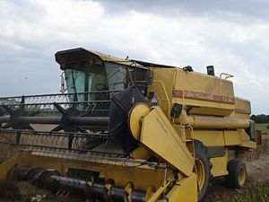 New Holland Agriculture - New Holland TX34 harvesting oilseed rape