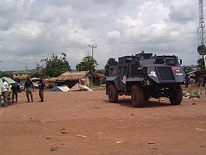 Nigerian Mobile Police with Vehicle