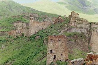 Vainakh tower architecture - Ruins of Nikaroi settlement. A residential tower in foreground of the image.