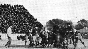 1905 Northwestern Purple football team - Rueber running with the ball in the Chicago game.