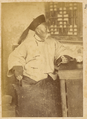 Old Manchu Gentleman in Padded Silk Jacket and Gown with a Jade Archer's Ring (Banzhi) on His Left Thumb. China, 1874-75 WDL4137.png