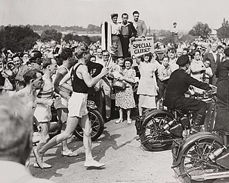 Wembley Park - The Olympic Torch arriving at Empire Stadium in the 1948 Summer Olympics