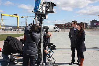 Daily Planet (TV series) - Co-hosts Ziya Tong and Dan Riskin on location in Northern Ireland during the opening of Titanic Belfast, April 2012