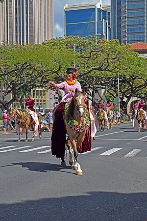 Pa'u riders - The Pa'u Queen of the 100th Anniversary Kamehameha Day Floral Parade. June 11, 2016