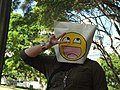 Paper bag mask with 4chan smiley at Anon raid.jpg