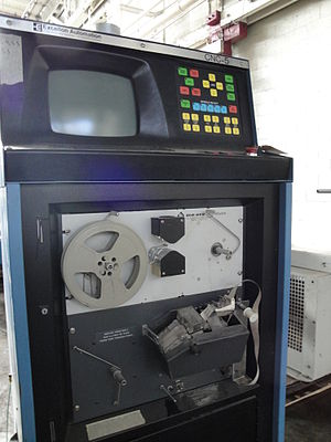 History of numerical control - Paper tape reader on a computer numerical control (CNC) machine.