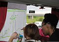 Participants draw on a white board during resiliency training at RAF Mildenhall, England, May 17, 2013 130517-F-DL987-201.jpg