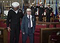Paul Moore, the last Pearl Harbor survivor in the Hampton Roads area, right, is ushered away after being honored during a Pearl Harbor remembrance ceremony. (25046028618).jpg