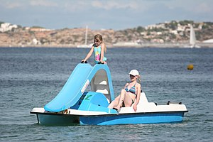 English: Womand and child on a pedalo with sli...